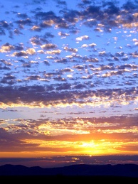 Altocumulus stratiformis duplicatus at sunrise in the California Mojave Desert, USA (higher layer orange to white; lower layer grey)