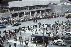 Motorcade of The Queen at the intersection of Yonge and Front Street, Toronto, during her 1959 royal tour.