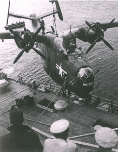 A U.S. Navy PBM of Fleet Air Wing 6 is hoisted aboard the seaplane tender USS Curtiss (AV-4) after a mine-hunting patrol off North Korea during the Korean War (1950-1953).