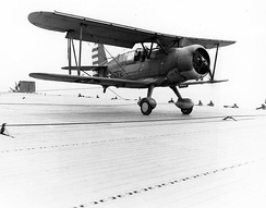 SOC-3A Seagull touches down on USS Long Island in April 1942, celebrating the carrier's 2000th landing