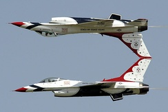 Two Thunderbirds perform a calypso pass.