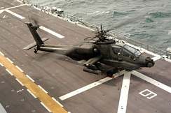 A U.S. Army AH-64A Apache aboard USS Nassau during Joint Shipboard Weapons and Ordnance training