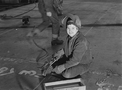 "A female welder at the Richmond Shipyards, Richmond, California, in 1943. Women factory workers embodied the ""Rosie the Riveter"" model."