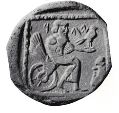 A 4th century BCE drachm (quarter shekel) coin from the Persian province of Yehud Medinata, possibly representing Yahweh seated on a winged and wheeled sun-throne.[97]:766[98]:190