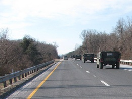 A military convoy of Humvees leaving Washington, D.C. the day after the Inauguration of Barack Obama