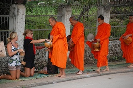 Buddhist monks on daily alms round.