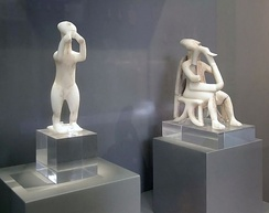 Cycladic statues of a double flute player (foreground) and a harpist (background)