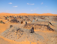 A Muslim cemetery in Sahara, all graves point across the desert placed at right angles to Mecca