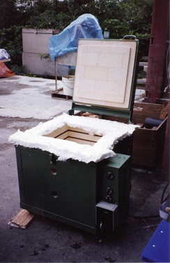 Fire test furnace insulated with firebrick and ceramic fibre insulation.