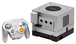 A Platinum GameCube with a WaveBird controller and Game Boy Player attachment