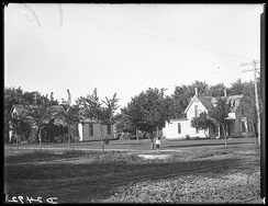 Streets of Kearney, Nebraska showing houses and one person, c. 1907