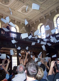 Results for the Cambridge Mathematical Tripos are read out inside Senate House and then tossed from the balcony