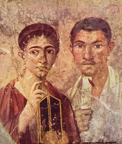 Pride in literacy was displayed in portraiture through emblems of reading and writing, as in this example of a couple from Pompeii (Portrait of Paquius Proculo).
