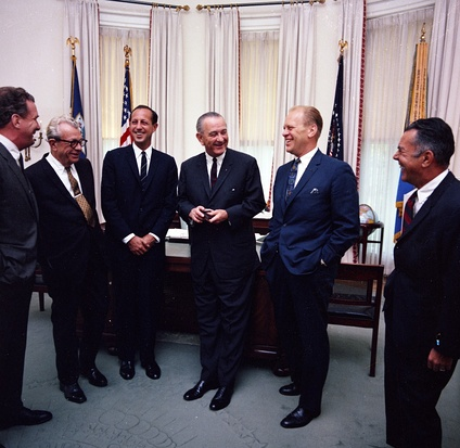 President Johnson with NFL owners and Republican Congressional leaders, June 7, 1967.L-R: Edward Bennett Williams (President of the Washington Redskins), Senator Everett Dirksen, NFL Commissioner Pete Rozelle, President Lyndon B. Johnson, Rep. Gerald Ford, unidentified (probably Rep. John W. Byrnes)