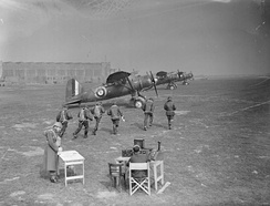 Crews of No. 400 Squadron RCAF run to their Westland Lysander aircraft during an exercise at RAF Odiham, England, 1941.