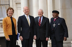 Tutu with Irish President Mary Robinson, British First Secretary of State William Hague, and former US President Jimmy Carter in 2012