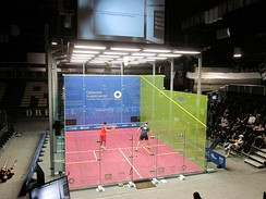 The glass show court used at the 2011 US Open Squash Championships hosted by Drexel University at the Daskalakis Athletic Center. 2 points during the Semi Final between James Willstrop and Nick Matthew in 2011  :[11][12]