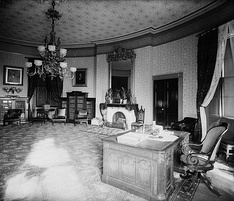 The Yellow Oval Room as President Grover Cleveland's library and study, 1886. Note his use of the Resolute desk.