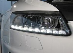 The ten (per side) LED daytime running lights (DRLs) - indicating a 10-cylinder engine