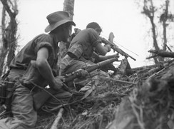 An Australian light machine gun team in action near Wewak, Papua New Guinea, in June 1945