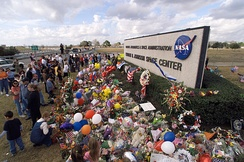 Entrance to JSC on February 1, 2003, with a makeshift memorial to the victims of the Space Shuttle Columbia disaster
