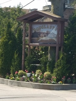 Douglaston Manor entrance sign