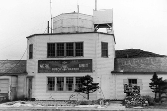 The building at Dutch Harbor airport used as communication room and terminal with the old U.S. Navy Aero Unit insignia in August 1972