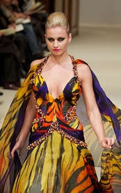 Model in a modern gown reflecting the current fashion trend at a Haute couture fashion show, Paris, 2011