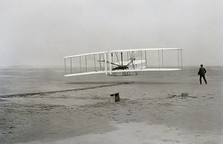 The first flight of an airplane, the Wright Flyer on December 17, 1903