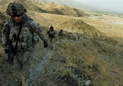 10th Mountain Division troops from the 1st Battalion, 32nd Infantry hike through Kunar Province.