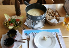 Fondue is melted cheese, into which bread is dipped