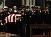 The casket of former President Gerald Ford is carried past President George W. Bush and First Lady Laura Bush during Ford's state funeral at the National Cathedral in Washington, D.C., January 2, 2007.