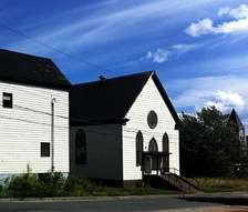 The former Congregation Sons of Israel synagogue, in Glace Bay. In 1902, the synagogue was Nova Scotia's first purpose-built synagogue. It permanently closed in July 2010. To the left is the also closed Talmud Torah community centre. This was the location of the Hebrew school and functions like Bar Mitzvah and wedding dinners.
