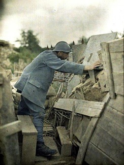 A 1917 Autochrome color photograph of a French Army lookout at his observation post during World War I.