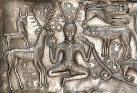 "Image of a ""horned"" (actually antlered) figure on the Gundestrup cauldron, interpreted by many archaeologists as being cognate to the god Cernunnos."
