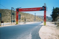 A sign erected after the 2006 Lebanon war in South Lebanon which displays rockets and Hezbollah leader Hassan Nasrallah