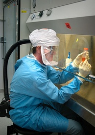 Dr. Terrence Tumpey examining a laboratory-grown reconstruction of the 1918 Spanish flu virus in a biosafety level 3 environment.