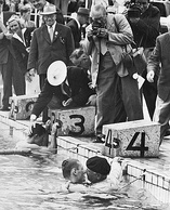After Jean Boiteux won the 400 m freestyle race his father jumped into the pool to congratulate him