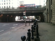 Looking east down Thames Street, at the London Bridge underpass, in c. 1965 (left) and in 2013 (right). The street has clearly become a major thoroughfare in today's City of London.