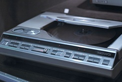 A top-loading, Magnavox-branded LaserDisc player with the lid open.