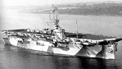 The USS Mission Bay operated primarily as an ASW carrier in the Atlantic. She is shown in August 1944 off the East Coast, wearing Measure 32 Design 4A camouflage. Note the Grumman F6F Hellcats on deck and the large SK air search radar antenna on the mast.