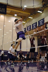Men's volleyball match in the Coles Center