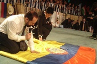 Pentecostal pastors pray over the Ecuadorian flag.