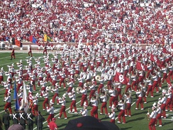 The Pride of Oklahoma Marching Band performs during pre-game and halftimes at football games.