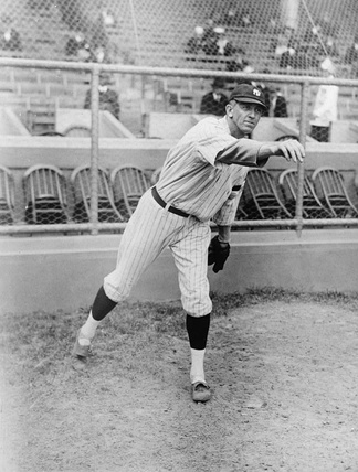 Raymond Benjamin Caldwell, Yankee pitcher, full-length portrait, facing right, with right arm extended outward after throwing baseball.