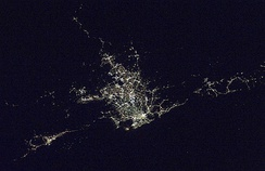 This satellite imagery shows Wollongong at night (bottom left), next to the Sydney area (centre).
