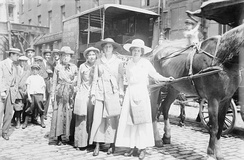 "New York, August 1913. ""Suffragettes on hike to Boston."" Front to back - Elsie McKenzie, Elisabeth Freeman, Vera Wentworth and 'Colonel' Ida Craft (with sash). 'Asquith' the horse pulled the caravan. According to contemporary reports he needed much urging, hence his name!"