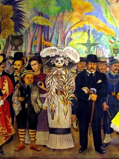 Detail of the 1947 Rivera mural,  Dream of a Sunday Afternoon in the Alameda Central. The mural includes a depiction of La Catrina, a popular satirical character that has become associated with Día de Muertos.