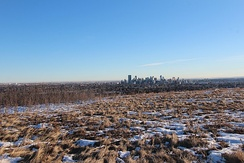 View of Calgary from Nose Hill Park. The city is located in a transition zone between the Rocky Mountain Foothills and the Prairies.