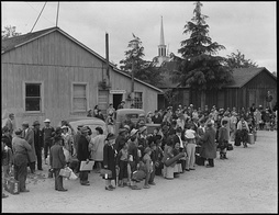 Families of Japanese ancestry being removed from Centerville, California during World War II.